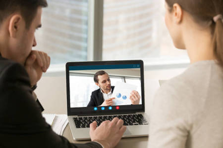 professional-workers-speaking-with-virtual-accountant-on-laptop